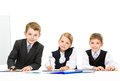 Group of little business people sitting at the table isolated concept teamwork and cooperation Stock Photos