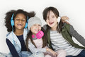 Group of Little Girls Studio Smiling Wearing Headphones and Wint Royalty Free Stock Photo