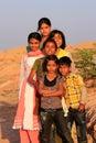 Group of local kids playing near water reservoir khichan villag village rajasthan india Stock Photo