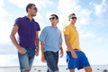 Group of male friends walking on the beach summer holidays vacation happy people concept Stock Images