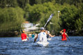 Group of man athletes canoeists boating on lake in a kayak rear view Royalty Free Stock Image