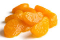 Group of mandarin segments in light syrup on white Stock Photography