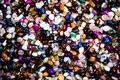 Group of many different natural gemstones. Collection of small colored semiprecious gemstones amethyst, lapis lazuli, rose quartz,