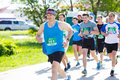 A group of marathon runners compete at the spring half maratho in omsk russia may athletes running on street Stock Images