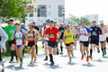 A group of marathon runners compete at the spring half marathon in omsk russia may athletes running on street Royalty Free Stock Images