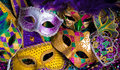 Group of Mardi Gras Mask on dark background with beads Royalty Free Stock Photo