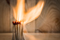 Group of match is ignite on a blurry wood background selective focus Royalty Free Stock Photography