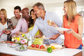 Group of mature friends enjoying buffet at dinner party Stock Photography