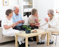 Group of mature people enjoying a game of cards Royalty Free Stock Photos