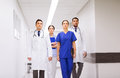Group of medics or doctors at hospital corridor Royalty Free Stock Photo