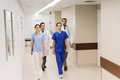 Group of medics or doctors walking along hospital Royalty Free Stock Photo