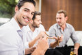 Group of men discussing smoking and drinking while Royalty Free Stock Image