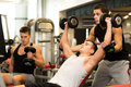 Group of men with dumbbells in gym sport fitness lifestyle and people concept Stock Photos