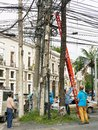 A group of men fixing cables in street of Manila