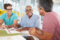 Group Of Men Meeting In Creative Office Royalty Free Stock Photo