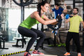 Group of men and woman in functional training gym women doing fitness exercise Stock Image