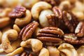 Group of mixed roasted nuts Royalty Free Stock Photo