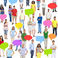 Group of multi ethnic diverse people with speech bubbles Stock Photography