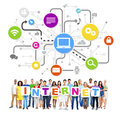 Group of multi ethnic people holding letters internet and relate related symbols above Royalty Free Stock Images