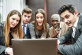 Group of multiethnic busy people looking at a laptop businesspeople teamwork Royalty Free Stock Image