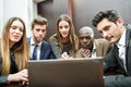 Group of multiethnic busy people looking at a laptop businesspeople teamwork Royalty Free Stock Images