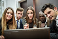 Group of multiethnic busy people looking at a laptop businesspeople teamwork computer Royalty Free Stock Images