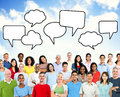 Group of multiethnic people with blank speech bubble multi ethnical standing beneath the bubbles Royalty Free Stock Photography