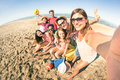Group of multiracial happy friends taking fun selfie at beach Royalty Free Stock Photo