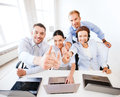 Group of office workers showing thumbs up business concept in call center Stock Image