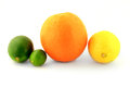 Group organic citrus fruits lemon orange lime and key lime assorted types over white background Stock Photos