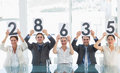 Group of panel judges holding score signs Royalty Free Stock Photo