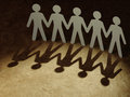 Group of paper people holding hands teamwork concept Royalty Free Stock Photos