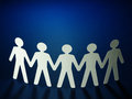Group of paper people holding hands teamwork concept Stock Photos