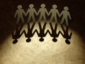 Group of paper people holding hands teamwork concept Royalty Free Stock Photo