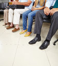 Group of patients in waiting room sitting a doctor Royalty Free Stock Photos