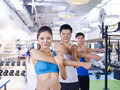 Group of people in aerobics class doing gym shallow depth field focus on the girl Royalty Free Stock Photo