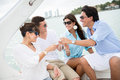 Group of people on a boat happy making toast Royalty Free Stock Images