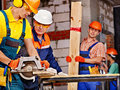 Group people builder with circular saw happy Royalty Free Stock Image