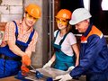 Group people builder cutting ceramic tile happy Royalty Free Stock Photos