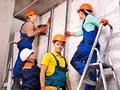 Group people in builder uniform happy indoor Stock Images
