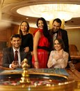 Group of people in casino young behind roulette table a Stock Images