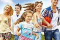 Group people with children running happy summer outdoor Stock Image