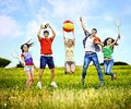 Group people with children running happy summer outdoor Stock Photos