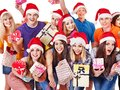 Group people and  Christmas tree. Royalty Free Stock Photo