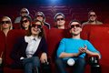 Group of people in cinema d glasses watching movie Stock Image
