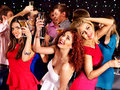 Group people dancing at party with champagne Royalty Free Stock Image