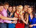 Group people dancing at party with champagne Stock Photo