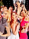 Group people dancing at party with champagne christmas Royalty Free Stock Image
