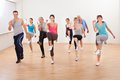 Group of people doing aerobics exercises large diverse in a class in a gym in a health and fitness concept Royalty Free Stock Photo