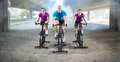 Group of people doing spinning on cycle bike Royalty Free Stock Photo